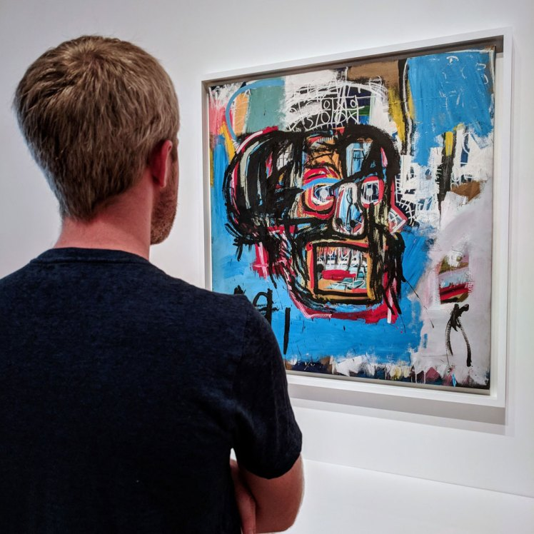"""Yonder Sky guide Daniel enjoying a temporary exhibition of Jean-Michel Basquiat's """"Untitled"""" (1982) while visiting Seattle Art Museum"""