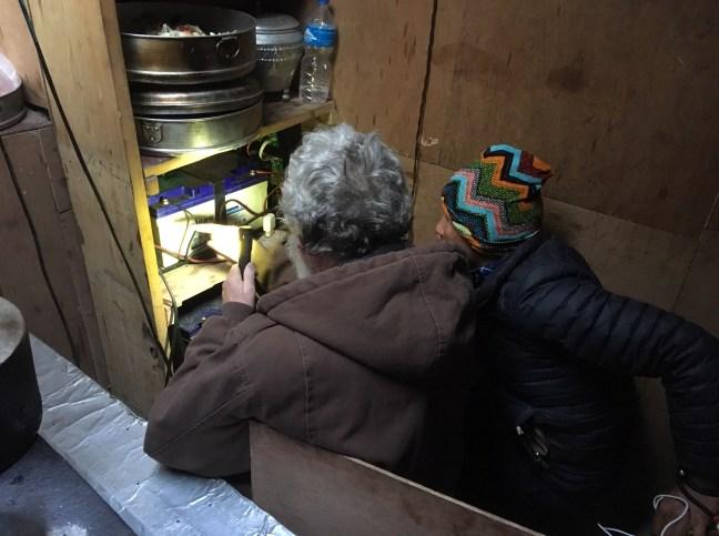 11. Pete Checking Dawa's Solar Equipment