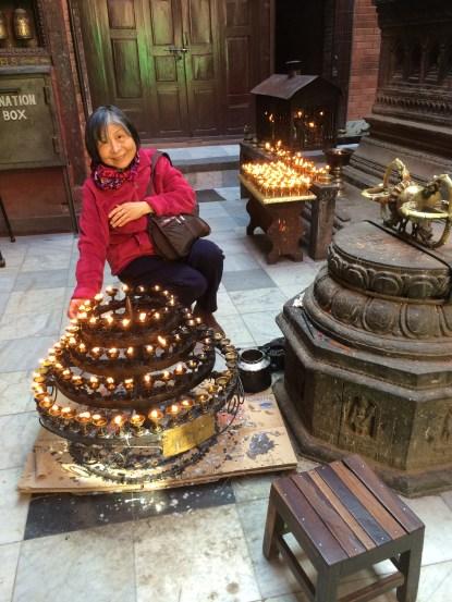 11. Lighting Butter Lamps at 10,000 Buddha Stupa