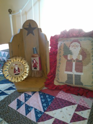 Some Santas on brooms and frames. The pillow is a Prairie Schooler pattern is is a special gift from my sister