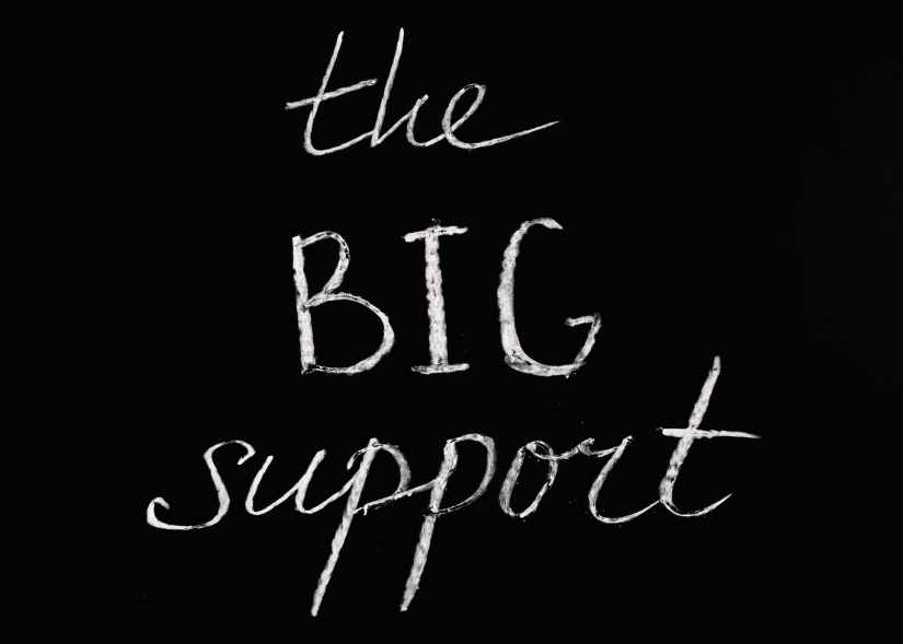 the big support lettering text on black background