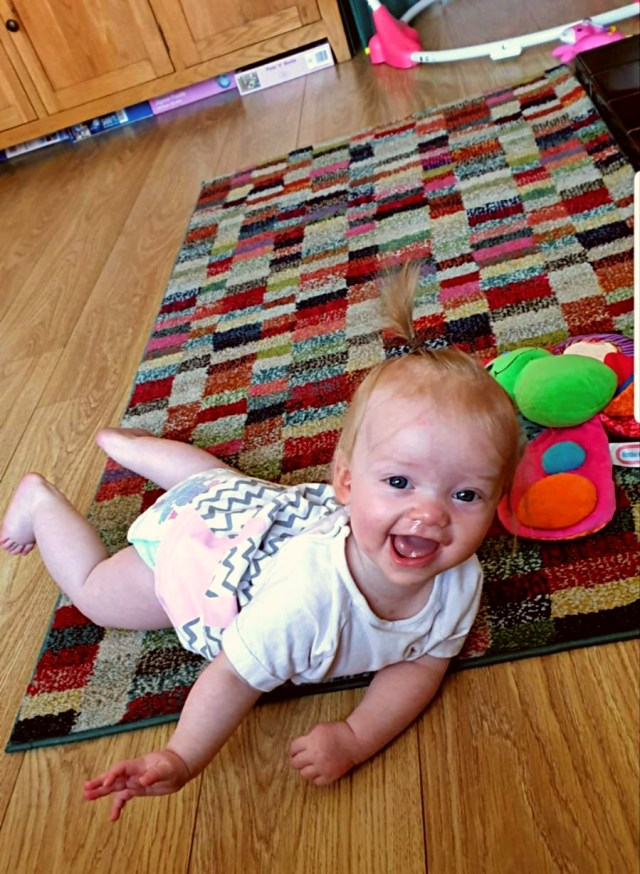 Beast rolling around. This is how she decided she would like to be mobile rather than attepmt to crawl, amazing moments to experience as the stay at home dad.