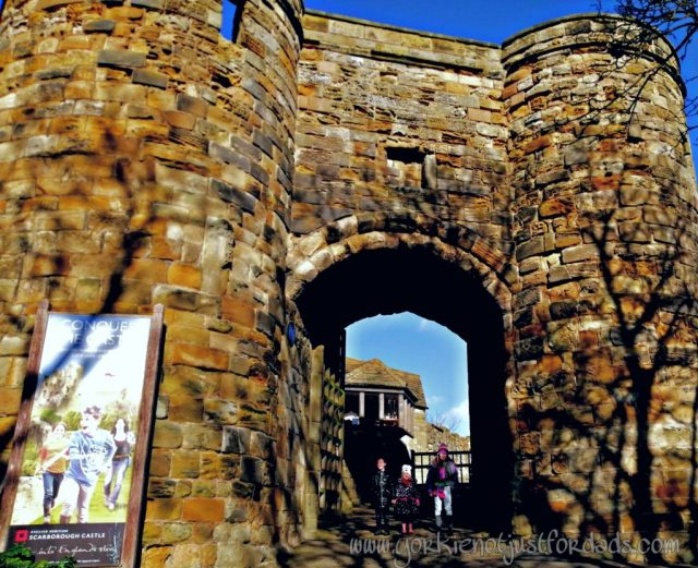 Through the Archway into Scarborough Castle. Pig Titch and Mouse await excitedly at the Gates.
