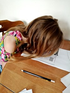 The joys of home Schooling, a Teenage moment with her head on the table.