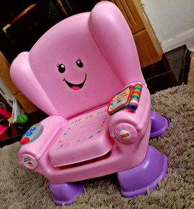 An image showing the pink laugh & learn smart Changes Chair from Fisher Price.