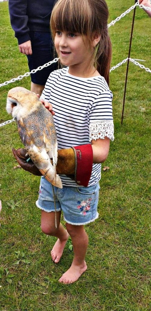Titch holding an owl