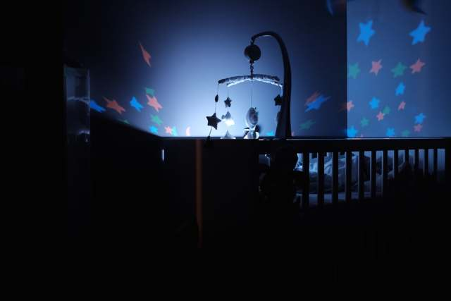 A dark room with soft light such as a nightlight can help with your child's bedtime and help them get to sleep while its still light outside after the clock change. The use of a blackout blind can help to block out the light.