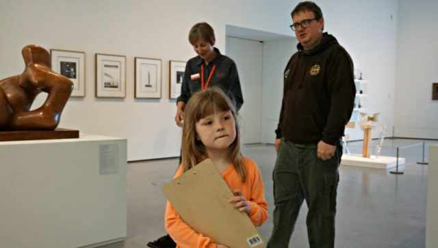 girl with clipboard at the hepworth wakefield rainy day