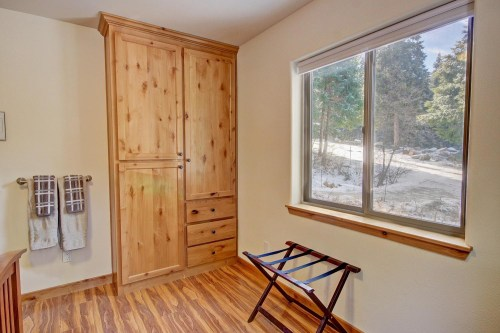 Built-in knotty alder cabinetry in the master bedroom as well