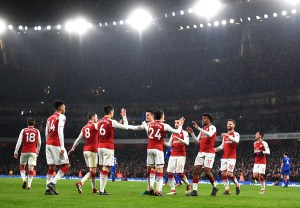 Arsenal players gather to celebrate Aaron Ramsey's first goal