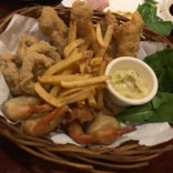 seafood basket including calamari rings, shrimp at art cafe in el nido philippines