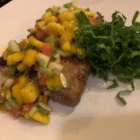 delicious pan fried white fish with mango salad at art cafe in el nido philippines