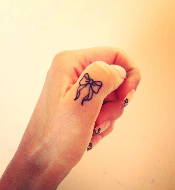 small cute finger tattoo design
