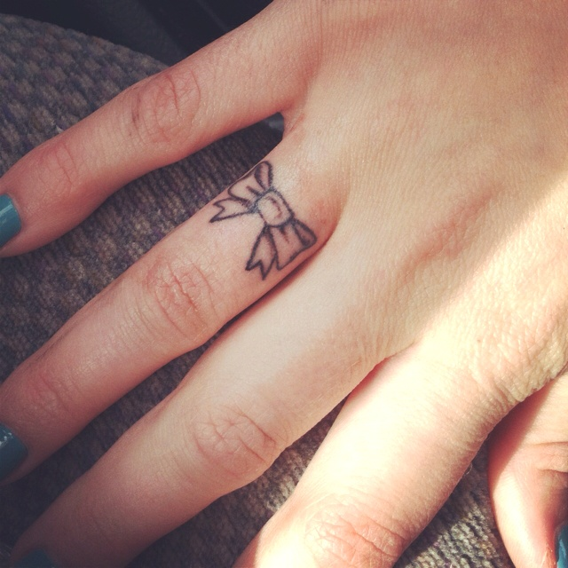 cute finger tattoo design