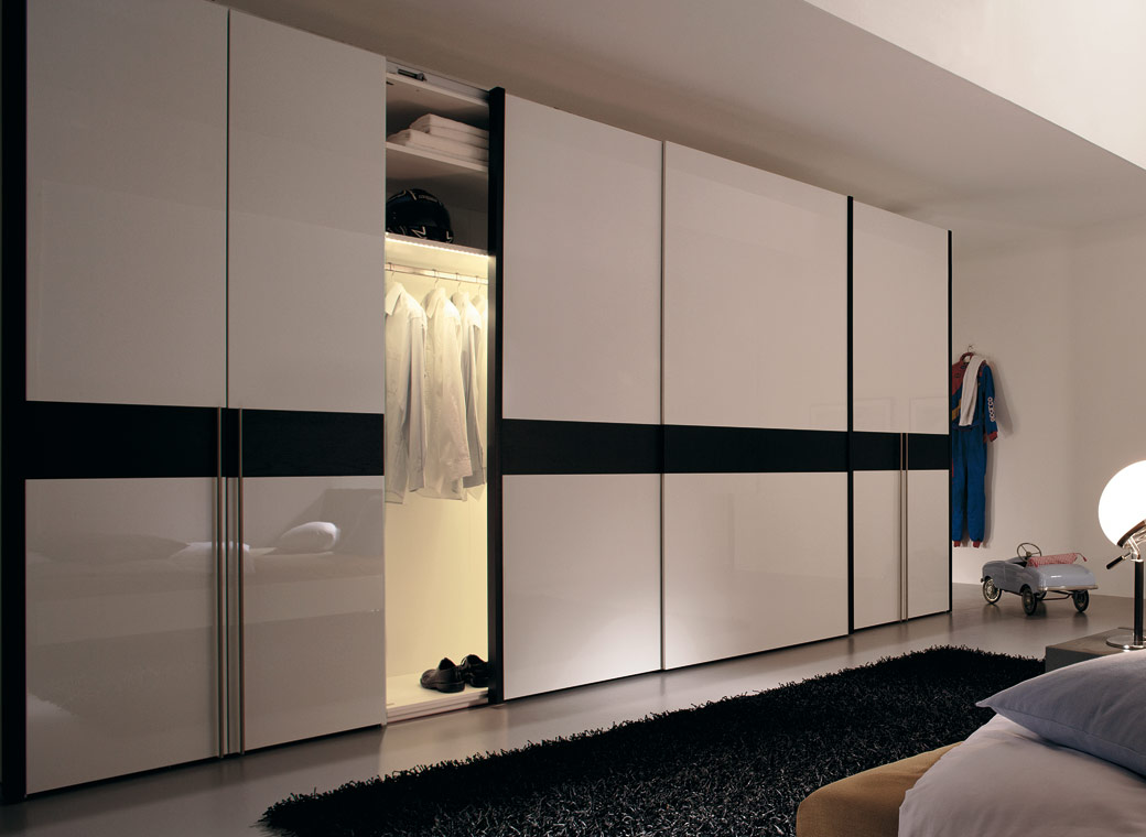 The Long Walled Contemporary Wardrobe Which Covers One Of The Four Walls Looks Cool Indians Very Rarely Accept These Types Of Wardrobes But They Make A