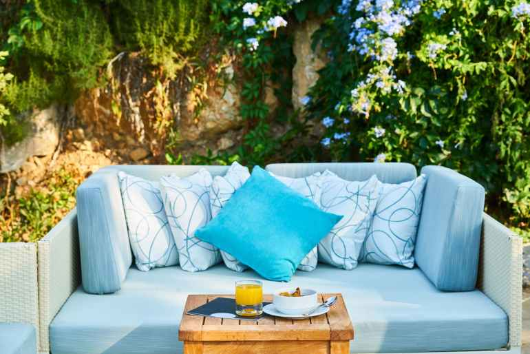 blue throw pillow and brown wooden table