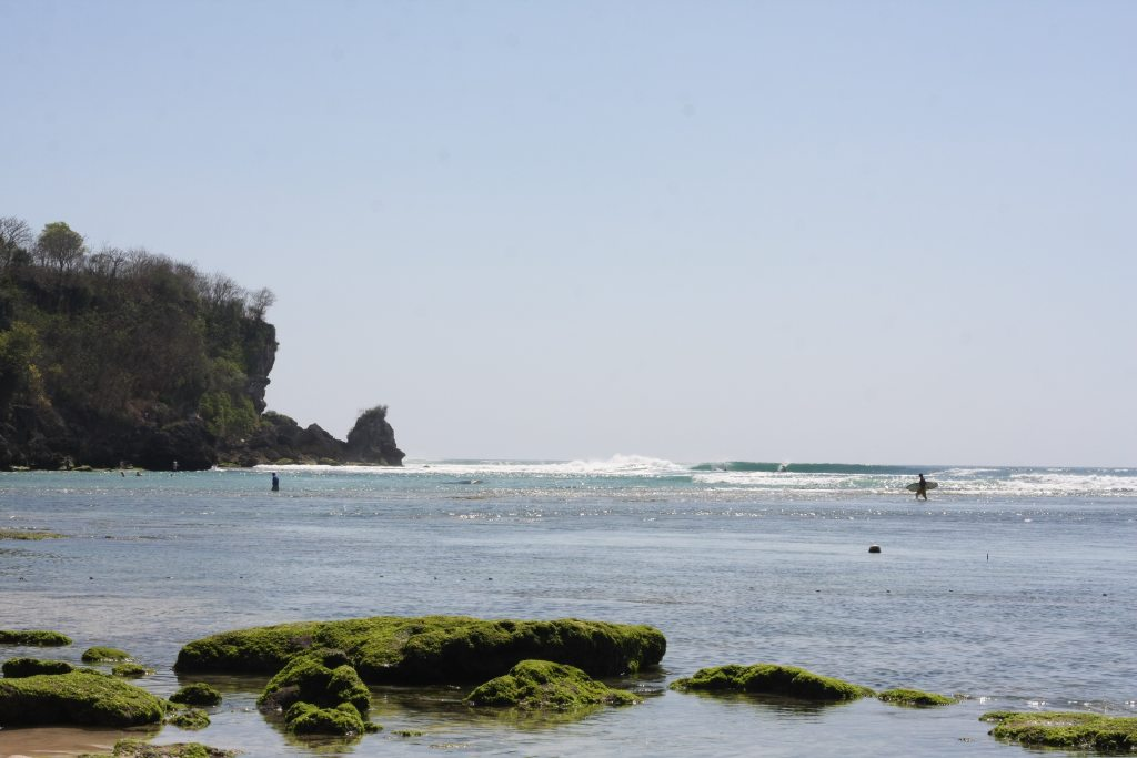 Looking over the reef at Padang Padang beach, Bali