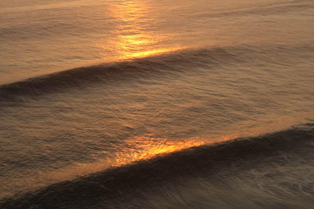 Waves at sunset at Uluwatu