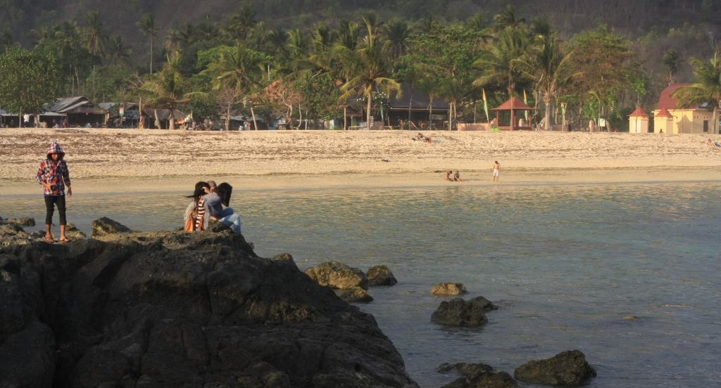 Indonesian people by the sea
