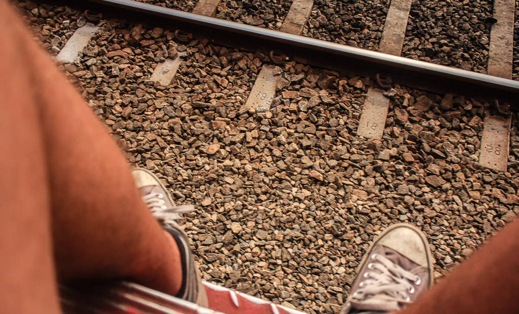 Train tracks and feet
