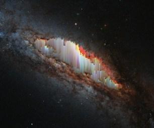 A bizarre cosmic rarity: NGC 660