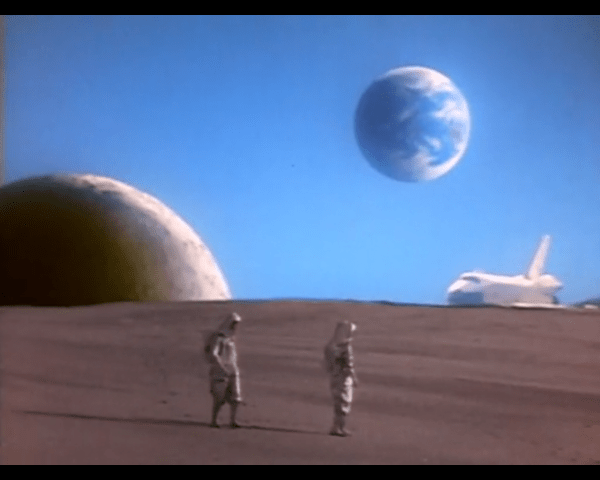astronauts standing on a desert planet that is still definitely not the moon, with a space shuttle behind them