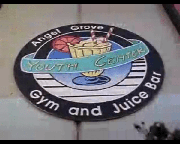 "A sign reading ""Angel Grove Youth Center: Gym and Juice Bar"""