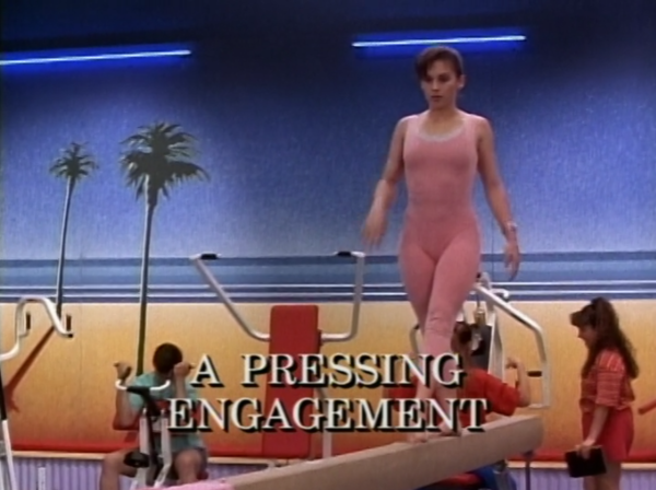 Kimberly in a light pink leotard. Very 90s.