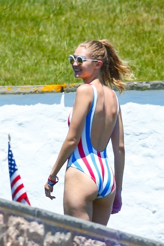Westerly, RI - Gigi Hadid and Karlie Kloss play football by the pool at Taylor Swift's house while security make their best efforts to distract the shutterbugs. Gigi is wearing a red, white, and blue striped one piece while Karlie Kloss bares more skin in an American Flag bikini. AKM-GSI July 4, 2016 To License These Photos, Please Contact : Maria Buda (917) 242-1505 mbuda@akmgsi.com sales@akmgsi.com Mark Satter (317) 691-9592 msatter@akmgsi.com sales@akmgsi.com www.akmgsi.com