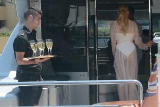Hailey Baldwin wears a sheer white dress as she boards a boat in Sydney
