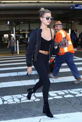 November 29, 2016: Hailey Baldwin arrives at LAX Airport, Los Angeles, CA. Mandatory Credit: INFphoto.com Ref.: infusla-319 Editorial Rights Managed Image - Please contact www.INSTARimages.com for licensing fee email sales@instarimages.com - Image or video may not be published in any way that is or might be deemed defamatory, libelous, pornographic, or obscene / Please consult our sales department for any clarification or question you may have - http://www.INSTARimages.com reserves the right to pursue unauthorized users of this image or video. If you are in violation of our intellectual property you may be liable for actual damages, loss of income, and profits you derive from the use of this image or video, and where appropriate, the cost of collection and/or statutory damage.