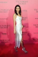 US model Kendall Jenner poses during a photocall after taking part in the 2016 Victoria's Secret Fashion Show at the Grand Palais in Paris on November 30, 2016. / AFP / Patrick KOVARIK / RESTRICTED TO EDITORIAL USE (Photo credit should read PATRICK KOVARIK/AFP/Getty Images)