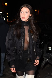 20 January 2017. Bella Hadid goes braless and shows off a bit of skin in a see through shirt as she dines out with Kendall Jenner & Joan Smalls at Kinugawa restaurant in Paris. Credit: Neil Warner/GoffPhotos.com Ref: KGC-195