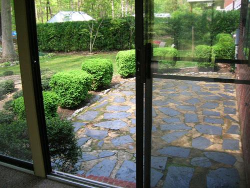 before photo of irregular cemented slate patio