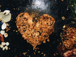 """At the end of our meal, they take left over ingredients, add dried seaweed, egg and fry all of it together right in front of us. The worker put our rice into a heart shape as an extra """"service""""."""