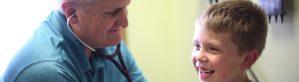 Pediatric doctor treating child patient