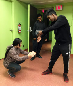 Catherine, Mohamed and Baale create a tableau in the Change the Image activity; Youth Artists for Justice program at YPT.