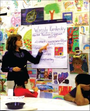 Young Picassos teacher Angelina Rodriguez leads an art class.