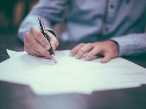 A man writing a plan