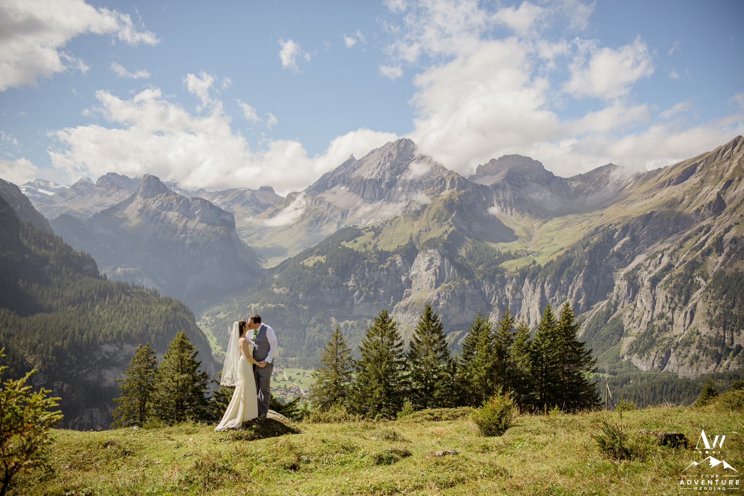 Couple kissing in front of the Swiss Alps