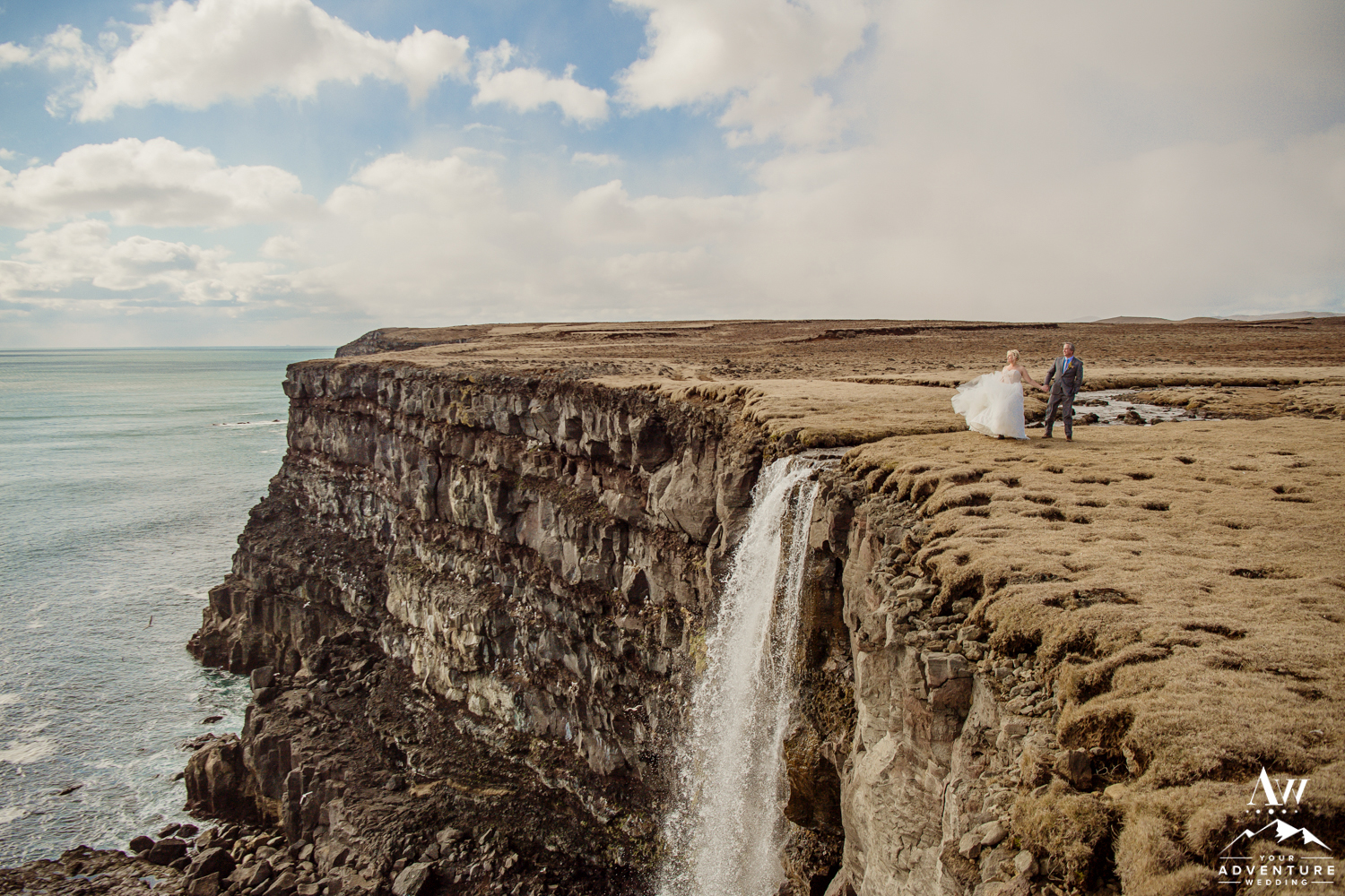 Iceland Elopement Couple on Cliff during wedding adventure