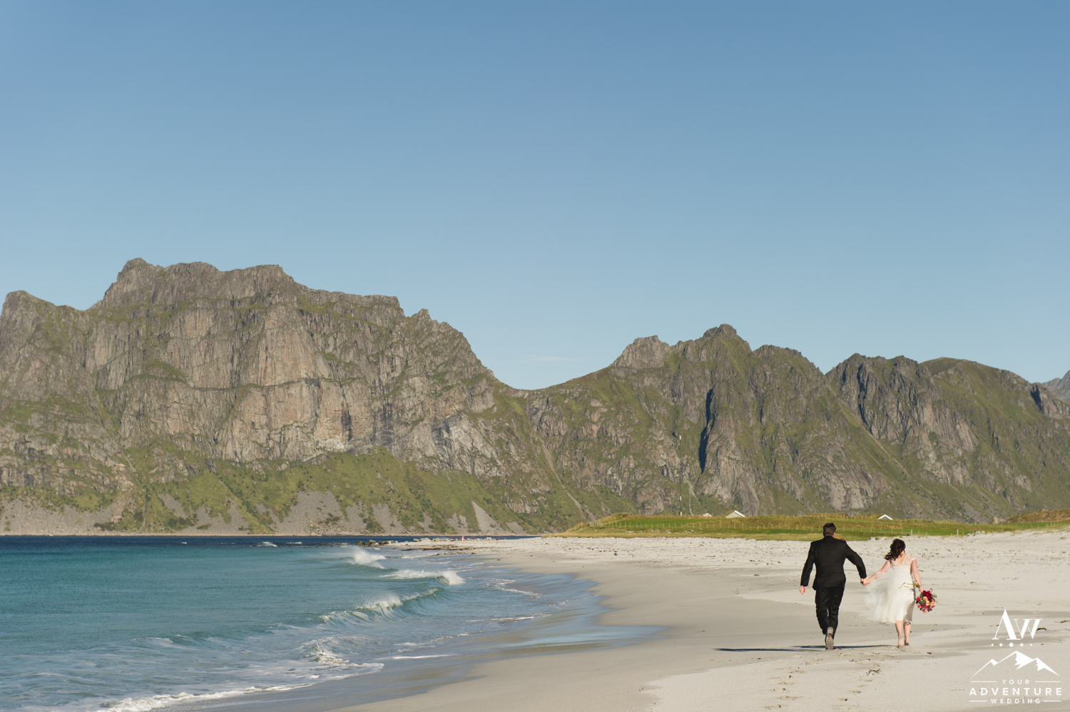 Couple Running on a white sand Beach in the Lofoten Islands