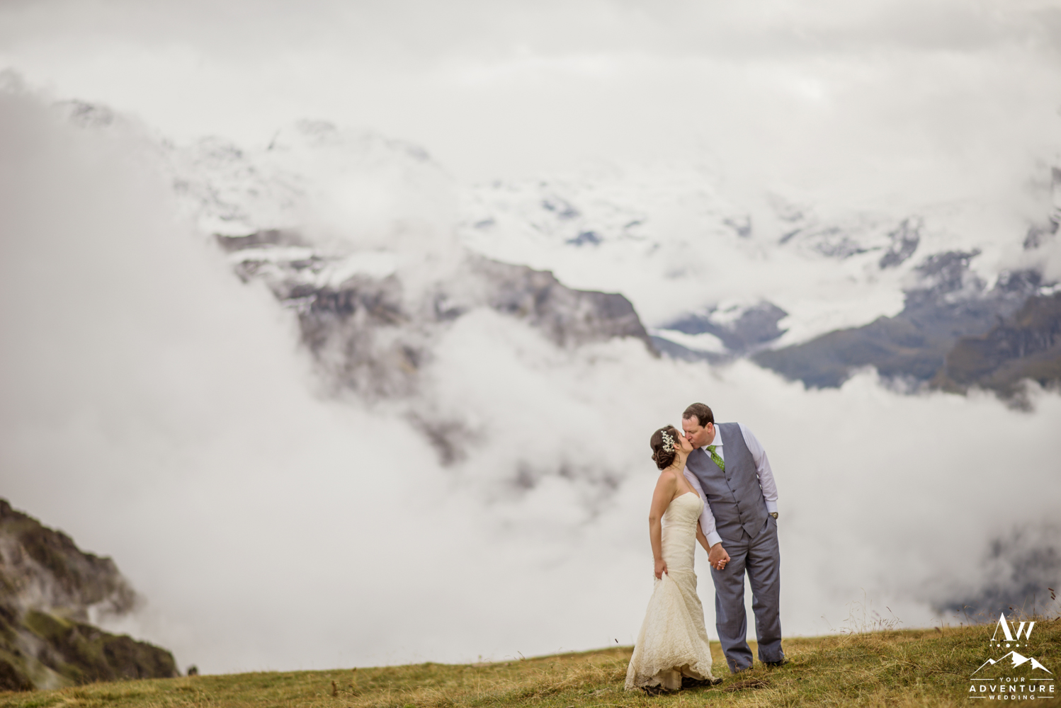 Couple kissing at the Männlichen Summit during Switzerland Elopement