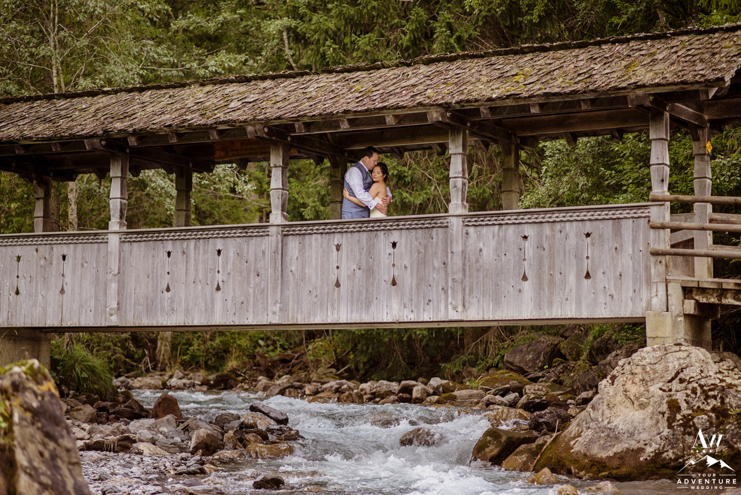 Wedding Couple at the covered bridge in Adelboden Switzerland