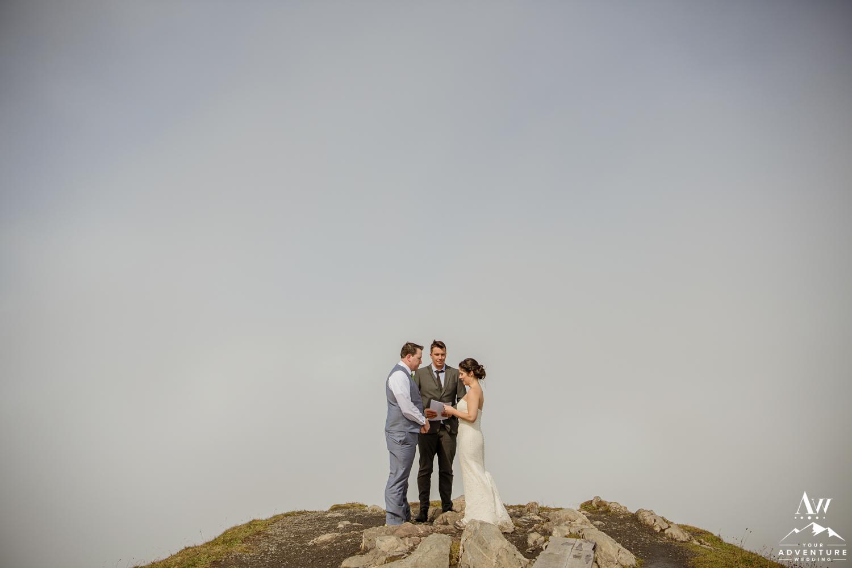 Bride saying her vows on top of the Männlichen during Switzerland elopement