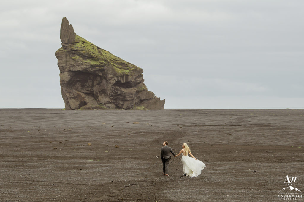 Hiking Elopement on black beach in Iceland
