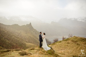 Couple Eloping on top of a mountain at sunrise