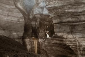 Iceland Wedding Couple inside of an ice cave waterfall