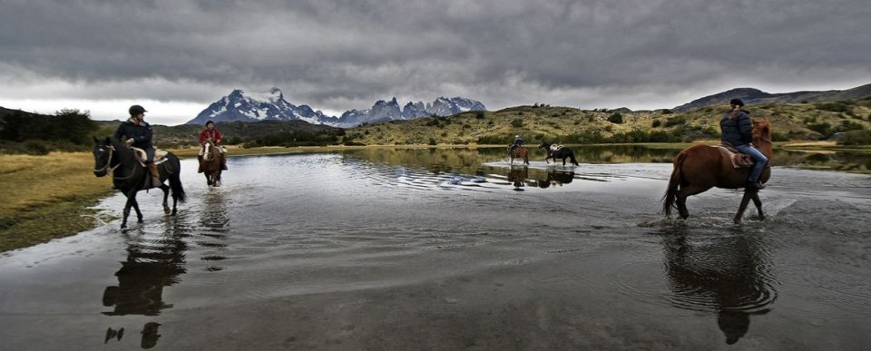 People horseback riding in Chile
