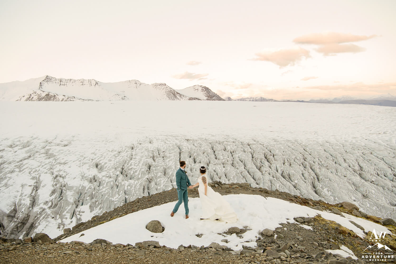 Iceland Elopement Couple Looking at a Glacier